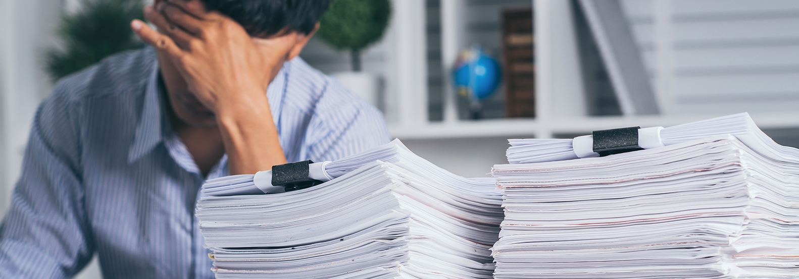 Man searching through stack of papers for mortgage release